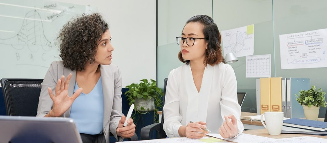 Businesswoman discussing new strategy with colleague at meeting