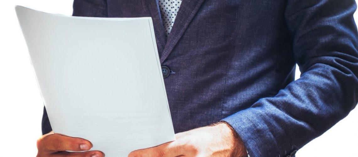 businessman-reading-project-documentation_t20_AeV1Ey