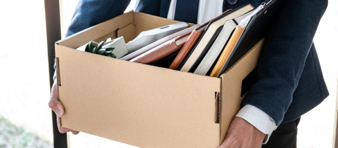 images-of-businessman-carrying-packing-up-all-his-personal-belongings-and-files-into-a-brown_t20_R074KJ
