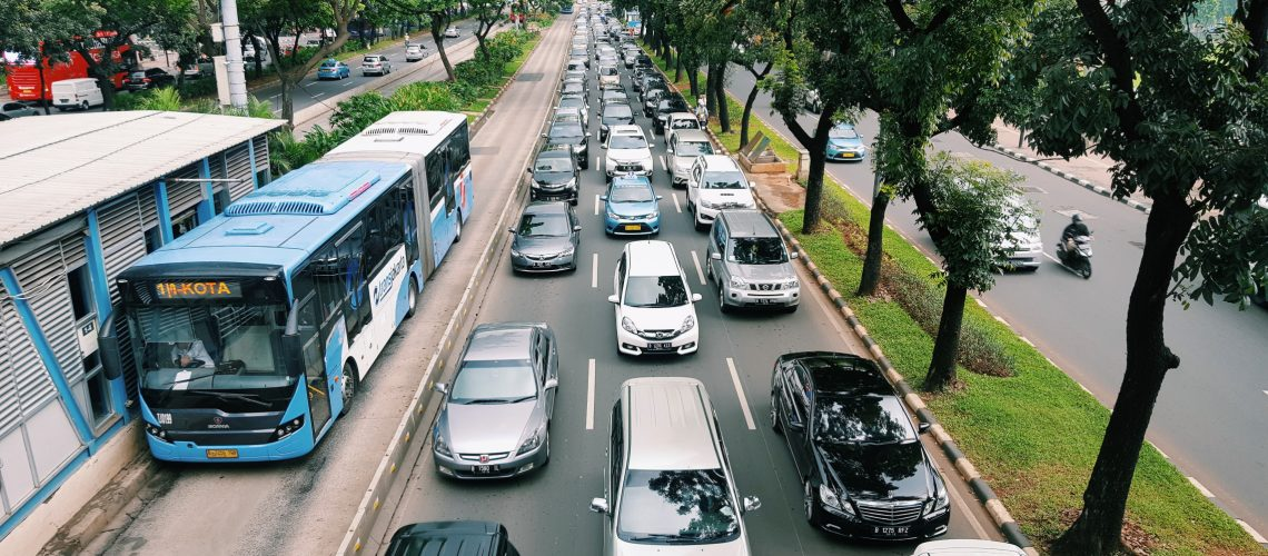 road-transportation-bus-city-life-clouds-traffic-jam-trees-cars-motorcycles-bus-stop_t20_lWVE3m